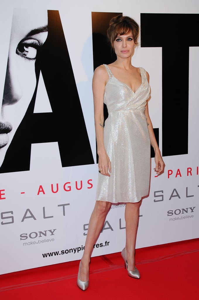 Angelina switched up her red carpet styles with this shimmering ivory silk Pamella Roland dress and matching Ferregamo pumps in August 2010.