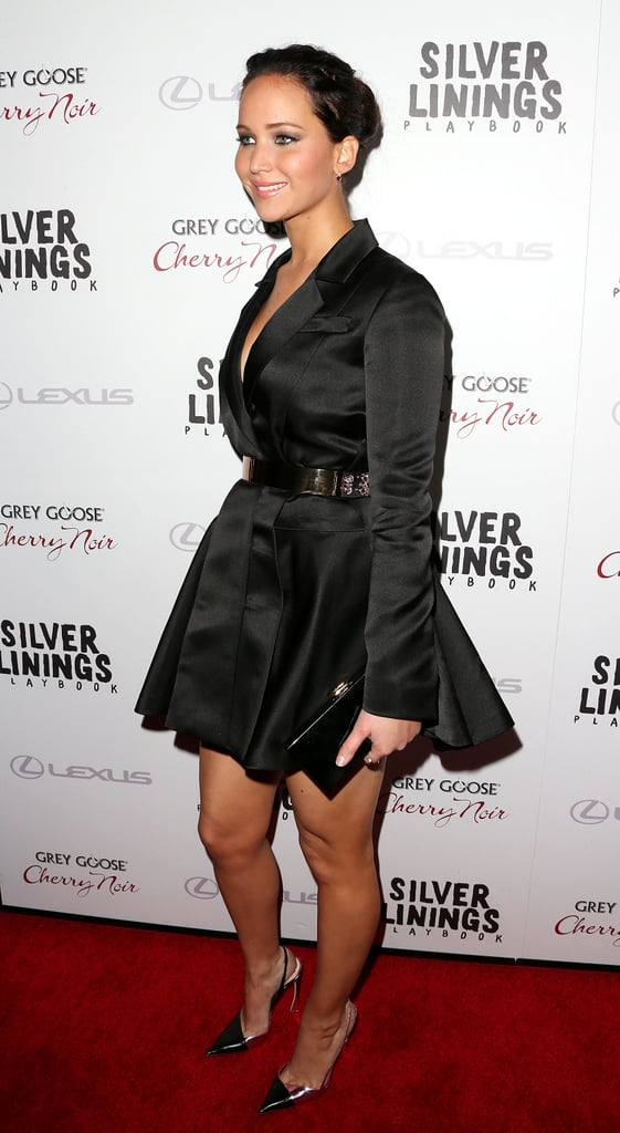 Jennifer Lawrence wore a short black dress with sleeves.
