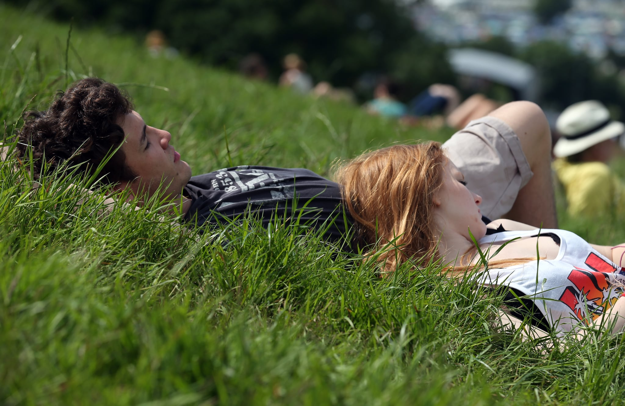 A pair rested in the grass at Glostonbury Festival in the UK.