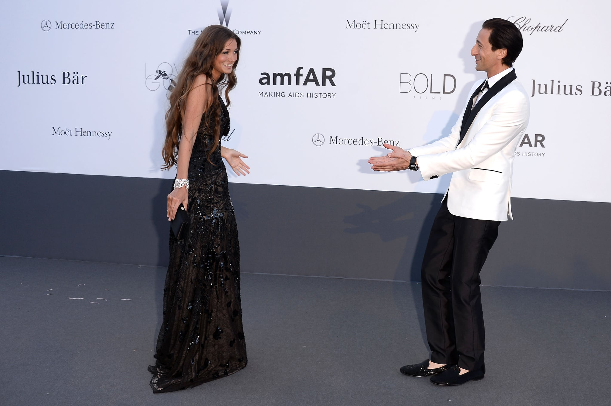 Lara Lieto and Adrian Brody teased each other on Thursday as they arrived at the amfAR in Cannes.