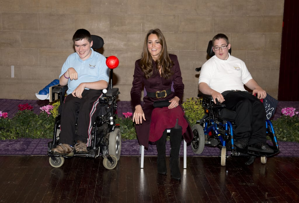 Kate Middleton took part in a ball tossing exercise with Richard Armstrong and Michael Bell from Percy Hedley School.
