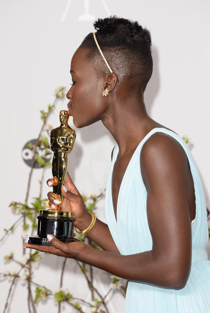 Lupita Nyong'o kissed her statue after snagging best actress for 12 Years a Slave.