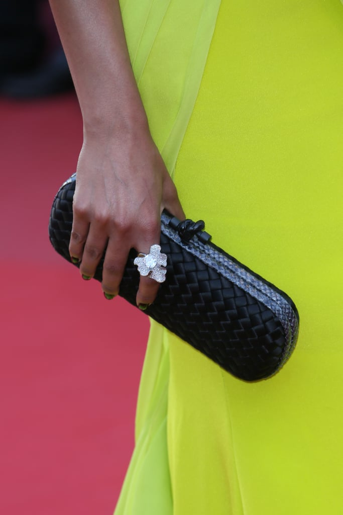 Selita Ebanks carried a black Alexander McQueen clutch and wore a Chopard ring.