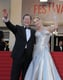 Uma Thurman and Arpad Busson waved to the crowd on Sunday before the Zulu premiere.