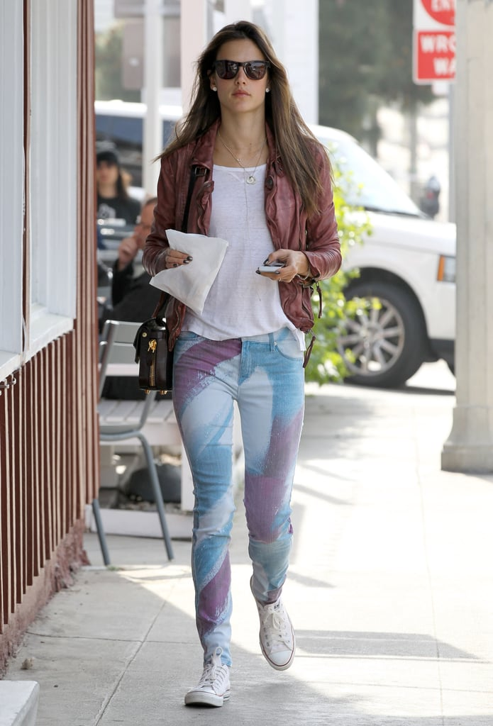 Alessandra Ambrosio showed off her California-girl brand of street style in printed skinny Hudson jeans and a leather jacket.
