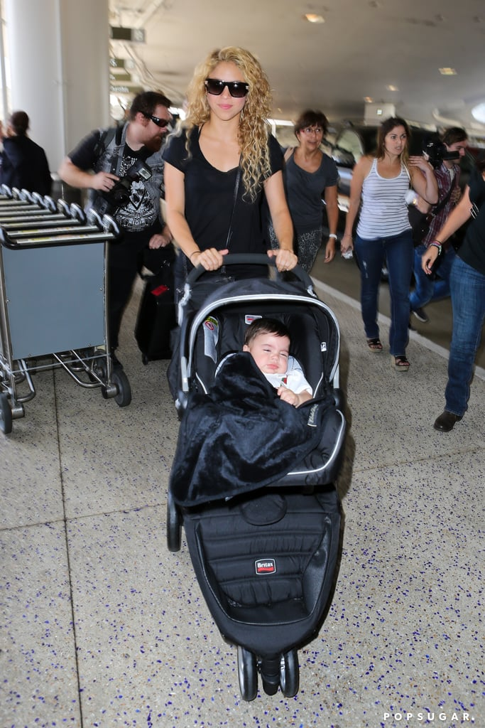 Shakira sported shades while heading through LAX with her son.