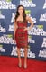 Nina donned one of her go-to red-carpet designers, Georges Chakra Couture, at the 2011 MTV Movie Awards — this time in a ruby and bronze bow-embroidered strapless dress iteration.