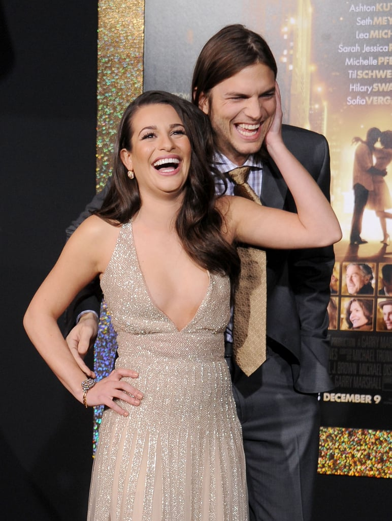 Lea couldn't contain her laughter on the red carpet with her New Year's Eve costar Ashton Kutcher at the film's LA premiere in December 2011.