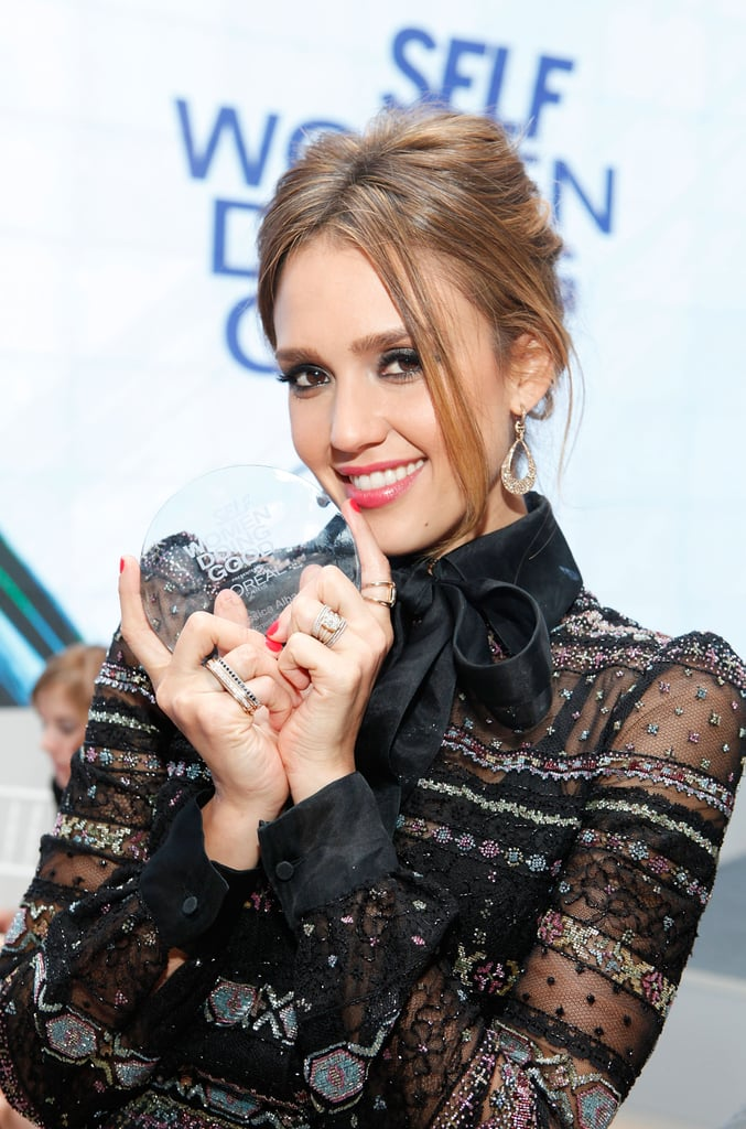 Jessica Alba showed off her award from the Self magazine Women Doing Good Awards in NYC.