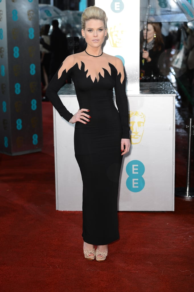 Alice Eve wore a black Alessandra Rich gown with a sheer top.