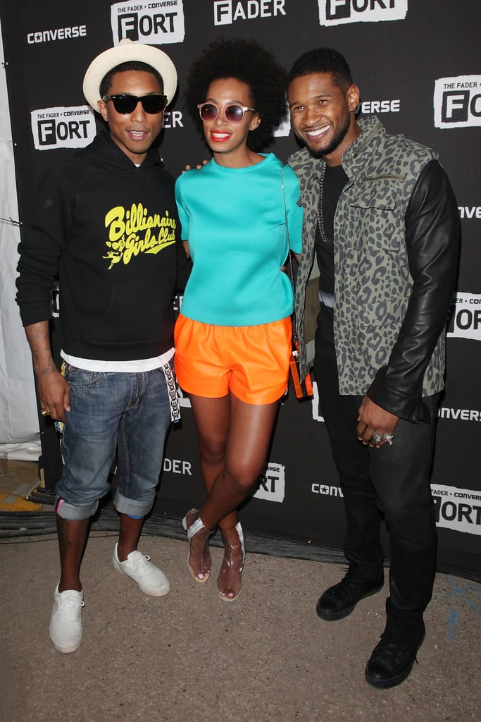 Solange brought a bright top and shorts set to pose alongside Pharrell Williams and Usher.