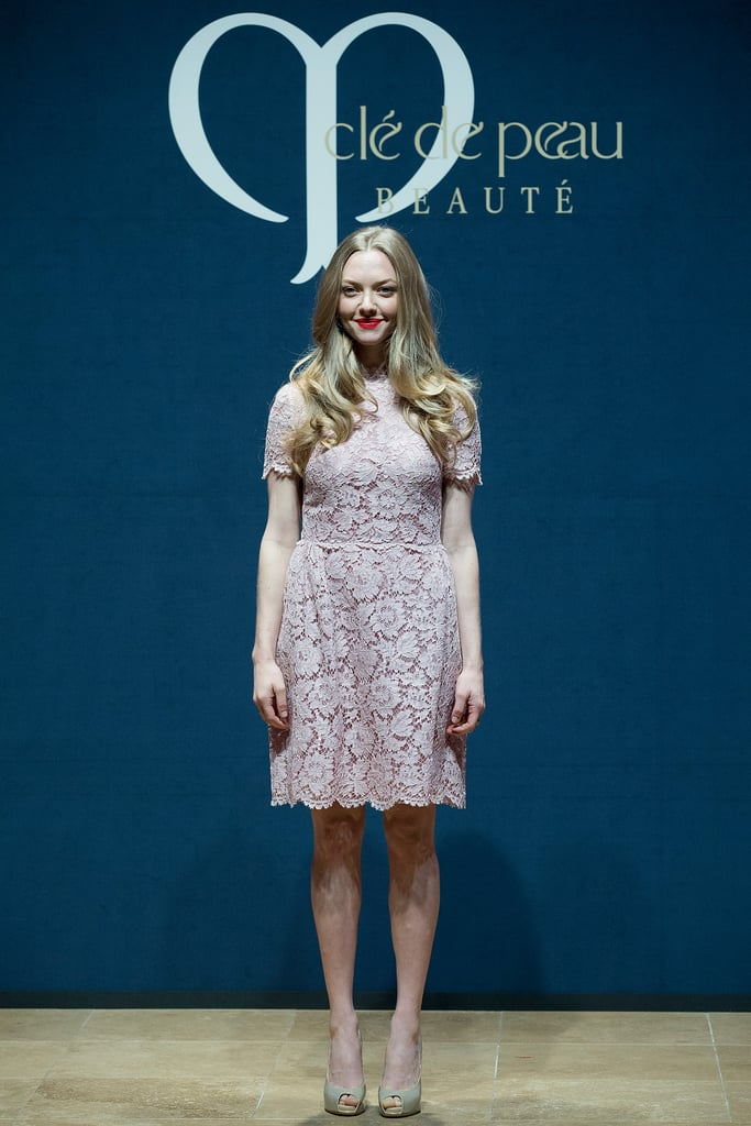 Also surprising: how quickly lace can go from sexy to sweet when you swap the color. Amanda Seyfried stepped out for Clé de Peau Beauté in a lovely pastel dress while maintaining some red with a bold scarlet pout.