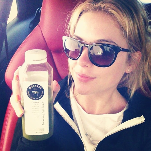 Ashley sips on healthy drinks like juice from Pressed Juicery.