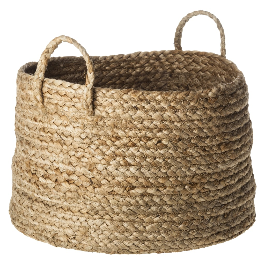 We can't get our fill of chunky, textural baskets, and this jute basket ($20) fits the bill.