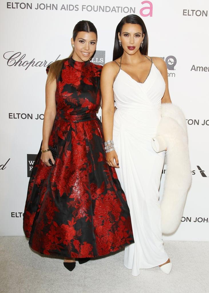 Kim Kardashian and Kourtney Kardashian walked the white carpet.