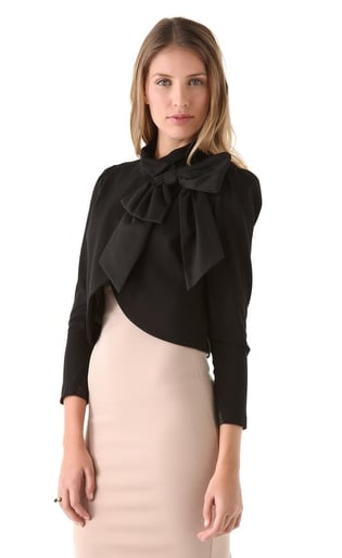 We can't get enough of the oversize bow on this Alice + Olivia black cropped jacket ($396). It's dressy and mature, but you can easily downplay it with denim or leather.