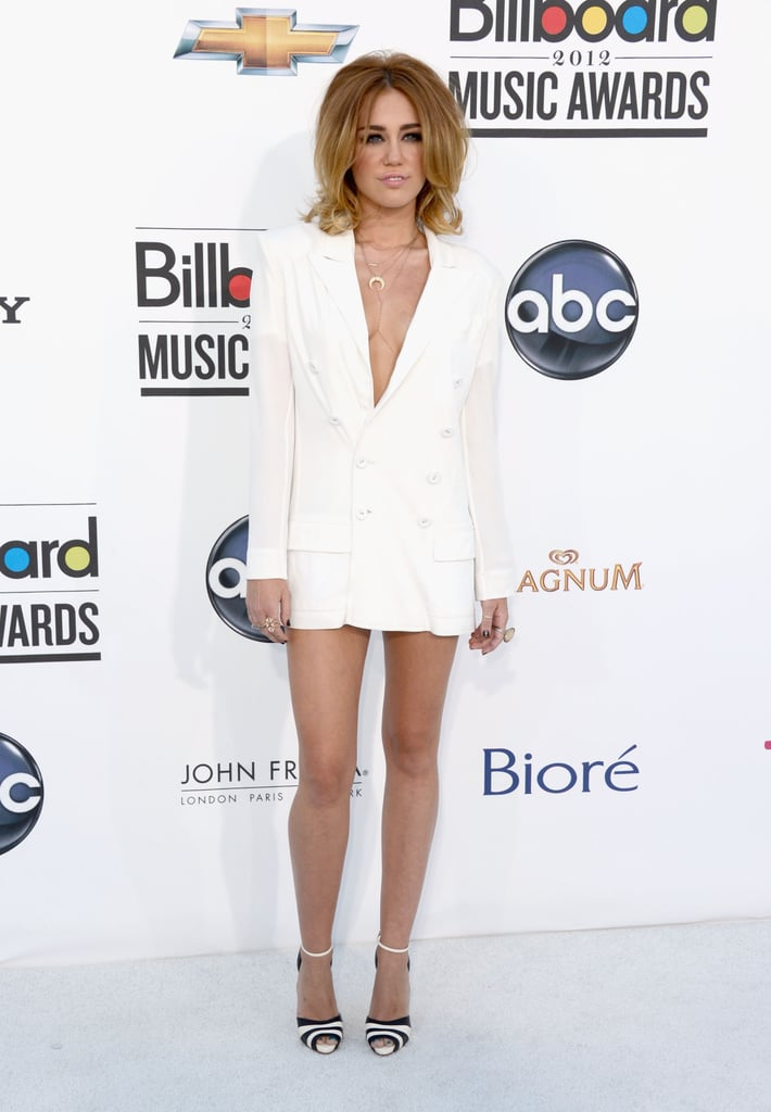 Miley Cyrus opted for a sexier version of menswear-inspired styles in a daring white, V-front Jean Paul Gaultier blazer-cum-dress. She finished the look with supercute ankle-strap Christian Louboutin heels.