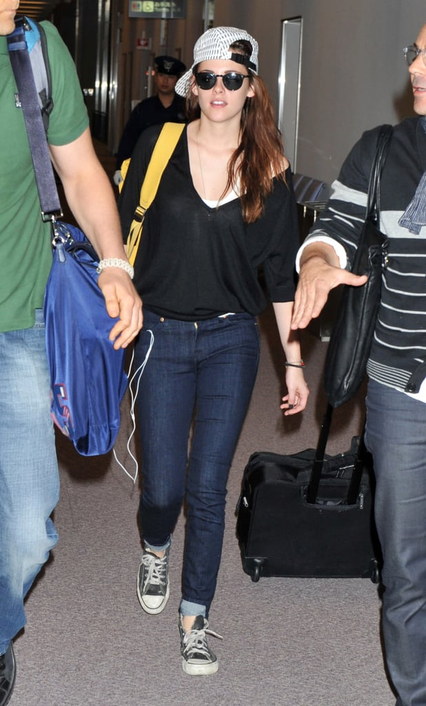Kristen Stewart wore sunglasses and a backwards baseball cap in the Tokyo airport.