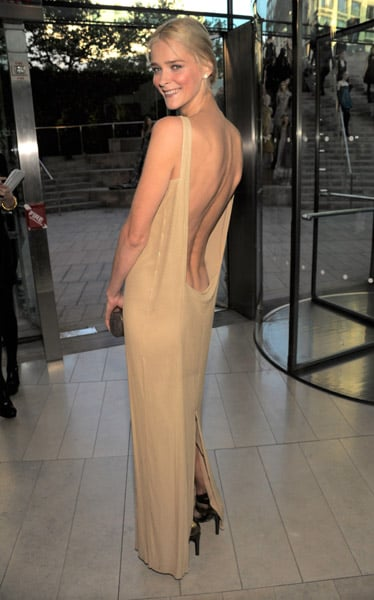 Carmen — in Michael Kors, of course — showing off her fine back.