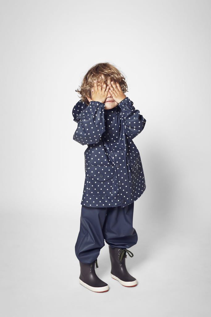 Rainy days are a lot more fun in a star-print raincoat and matching boots.