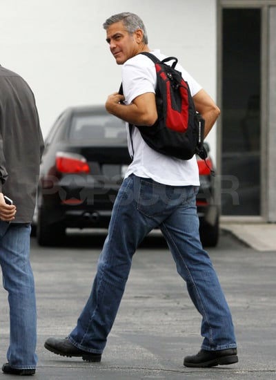 George Clooney carries a backpack.