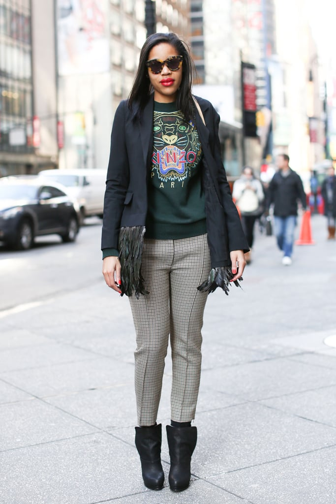 A statement sweatshirt was the edgy opposite to a feathered coat.