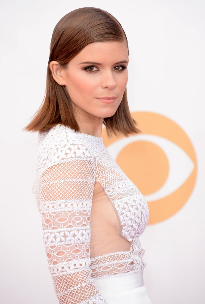 Kate Mara tried on the wet hair look, letting the ends flare out, while her eye makeup was accented with a touch of bronze eye shadow.