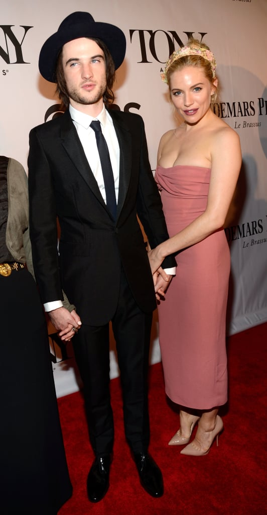 Sienna Miller showed off her eclectic red carpet style in a strapless dusty rose dress and a floral headpiece at the Tony Awards in NYC.
