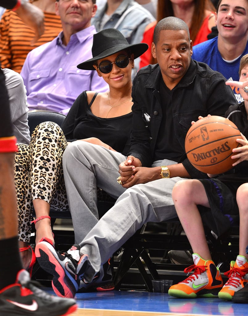 Jay-Z and Beyoncé Knowles watched sports.