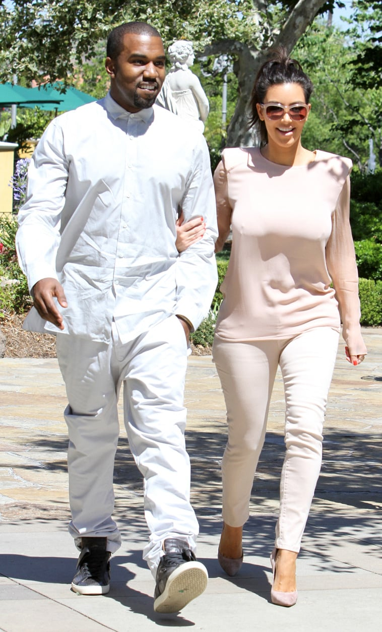 Kim held onto Kanye during an LA day out in June 2012.