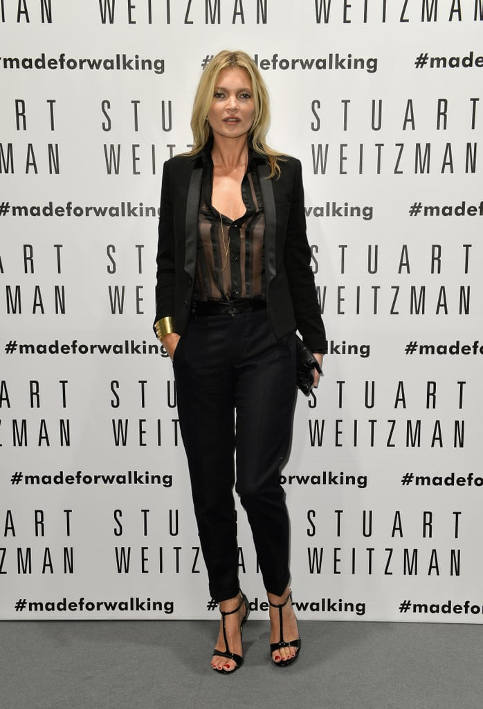 At the Stuart Weitzman flagship store opening in Milan, Kate Moss played it masculine in a black tuxedo suit. A sheer blouse and t-strap sandals lent an undeniably sexy twist.