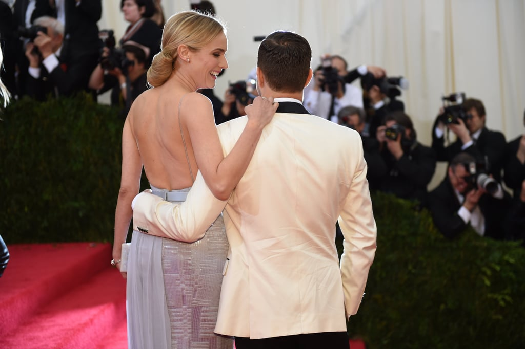 Diane Kruger and Joshua Jackson stayed close while posing for photographers.