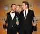 Breaking Bad costars Aaron Paul, Anna Gunn, and Bryan Cranston got kissy after winning their SAG Award.