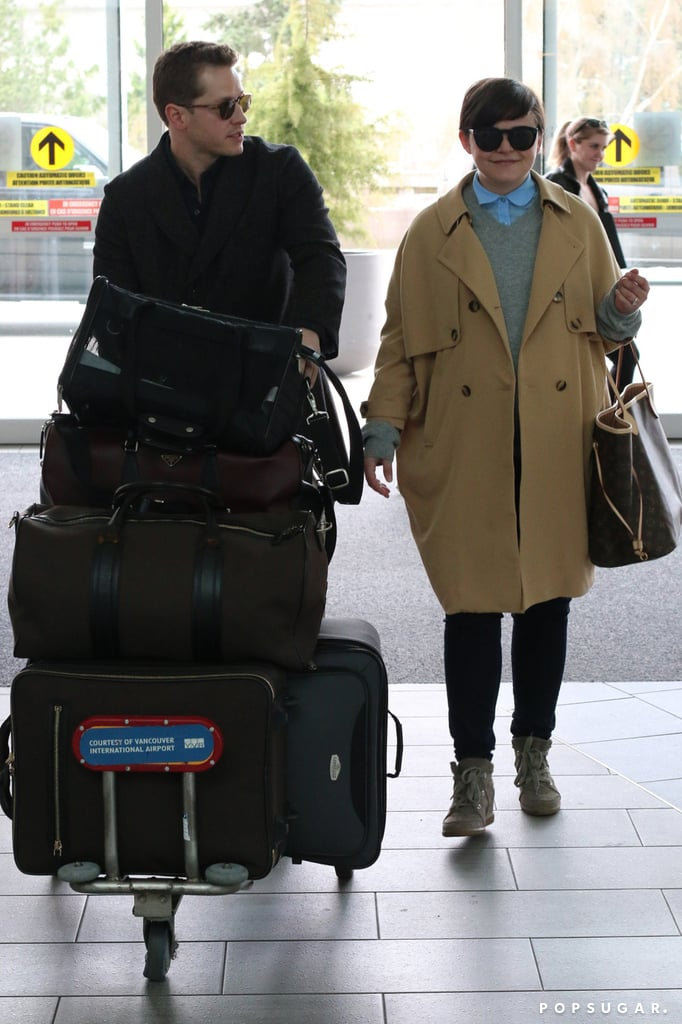Josh Dallas proved he's a real-life prince charming when he pushed his and pregnant fiancé Ginnifer Goodwin's luggage at Vancouver International Airport on Sunday.