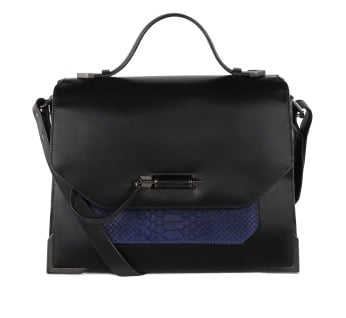 After perfecting the outwear game, Mackage has made bags! They avoided ODing on embellishment or hardware, which can quickly make a bag look garish. I'd include this black and navy blue pick ($495) in my stable any day. — LM