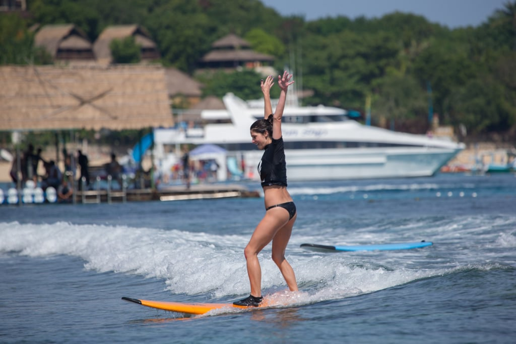 Ashley Greene was stoked about catching a wave in Bali in June.