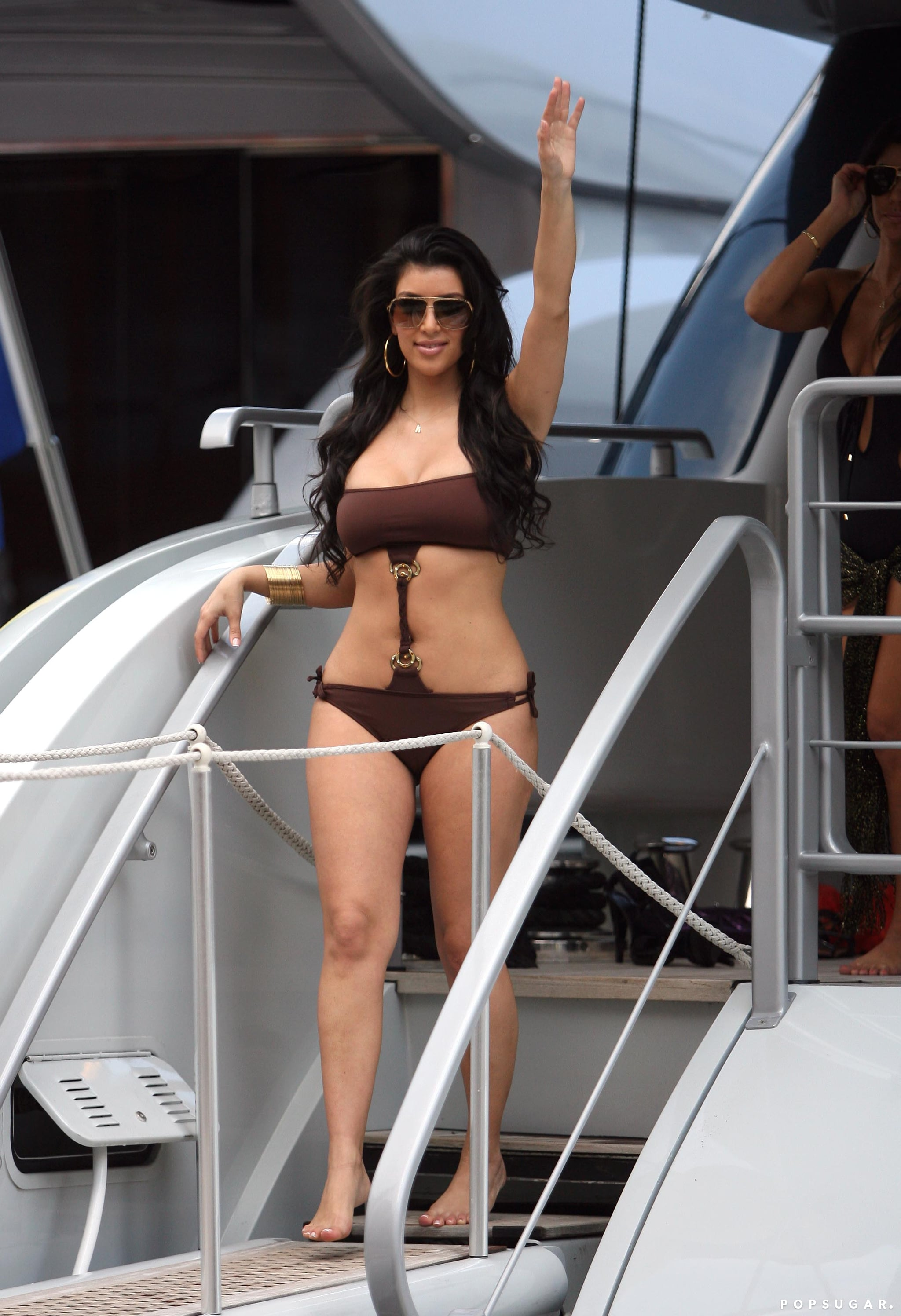 Kim waved to the camera while vacationing in Monte Carlo in June 2008.