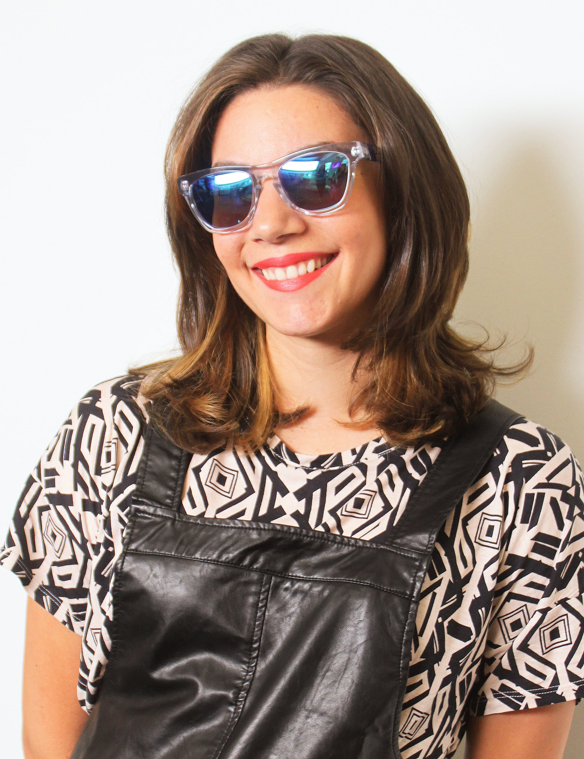 We're all about mirrored sunglasses, especially with cool clear legs and frames like on this pair ($153) from celeb-favorite Westward Leaning. The blue in the reflective lenses looks best with a contrasting lip color like MAC Neon Orange lipstick ($16).