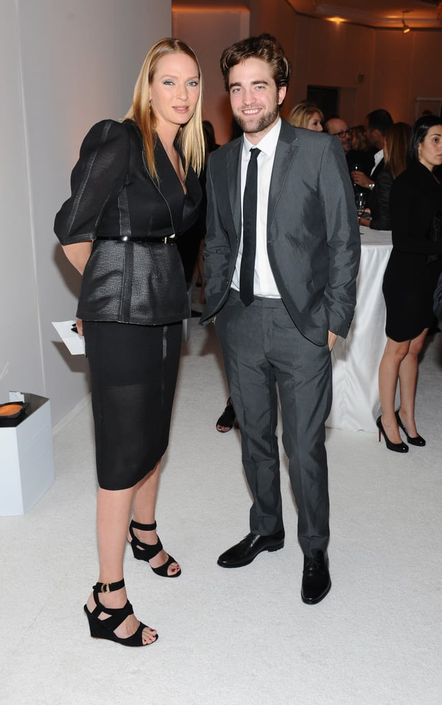 Uma Thurman stepped out in LA and posed for photos with Robert Pattinson at the Elle Women in Hollywood Awards.
