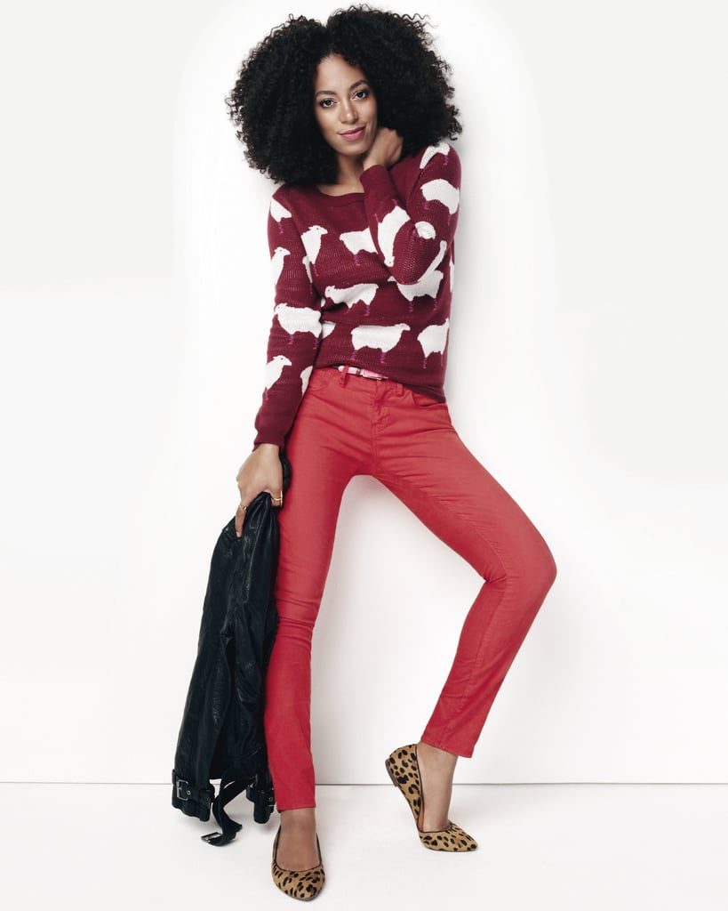 Solange gives us a lesson on bold colour in a pair of red skinnies, a printed sweater, and leopard flats.