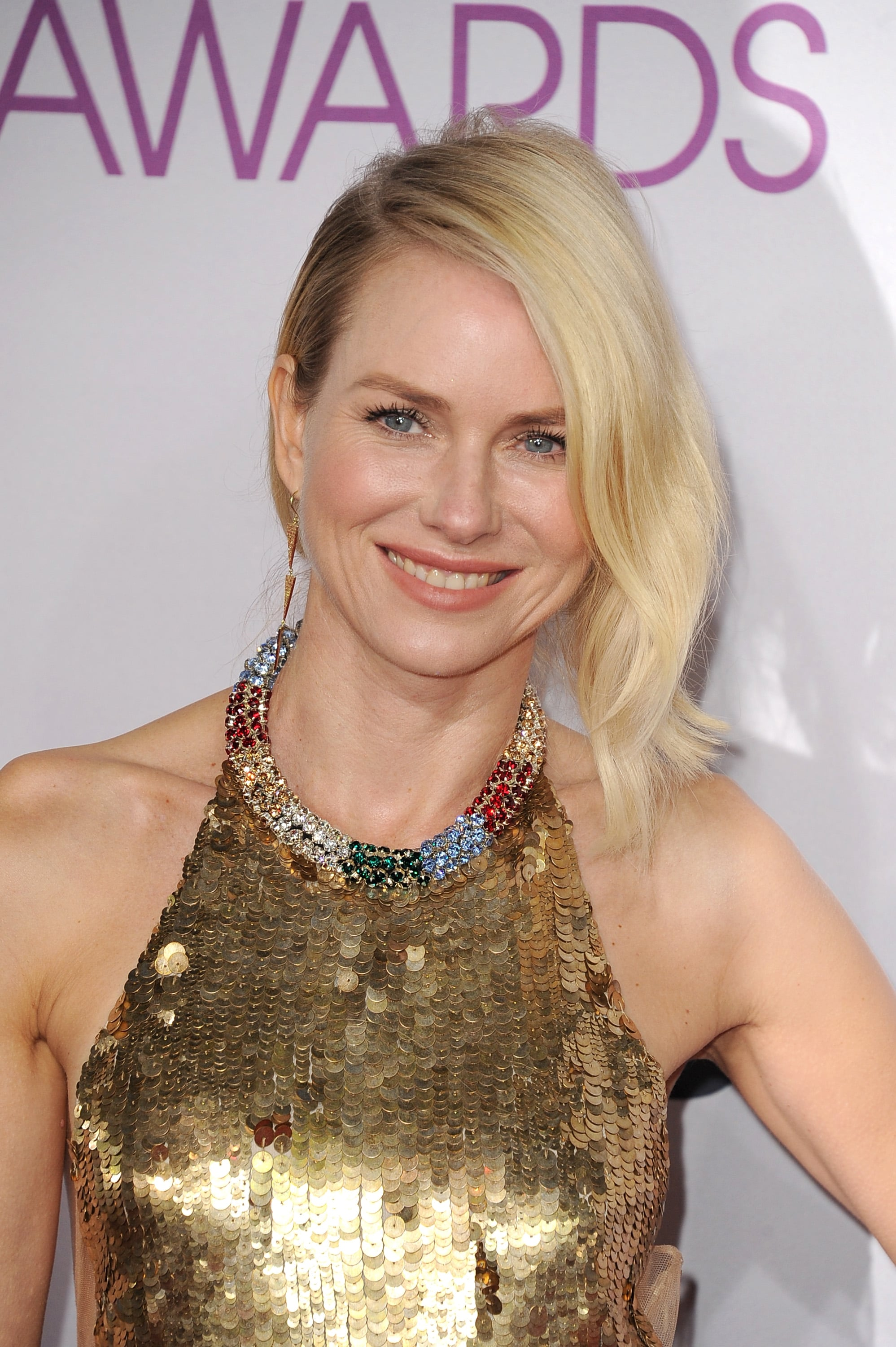 Naomi Watts was glowing in a gold Alexander McQueen gown.