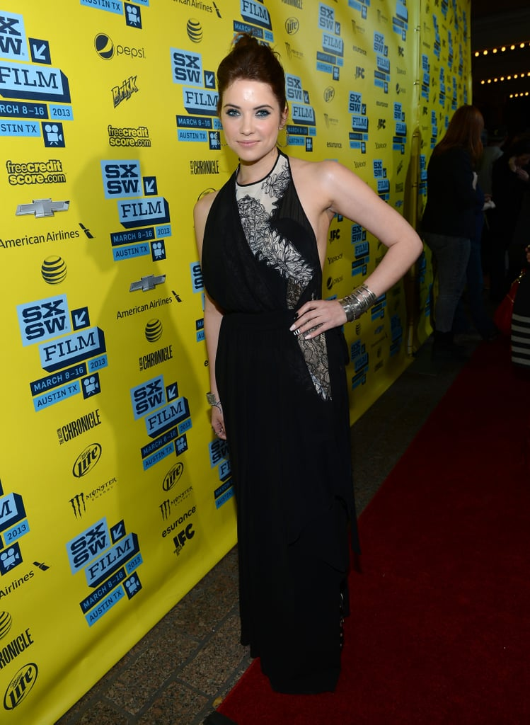 For the SXSW premiere, Ashley Benson chose a black halter-style gown, which featured feminine lace detailing on the bodice, and paired the look with blue-lined eyes, a bold metal cuff, and hoop earrings.
