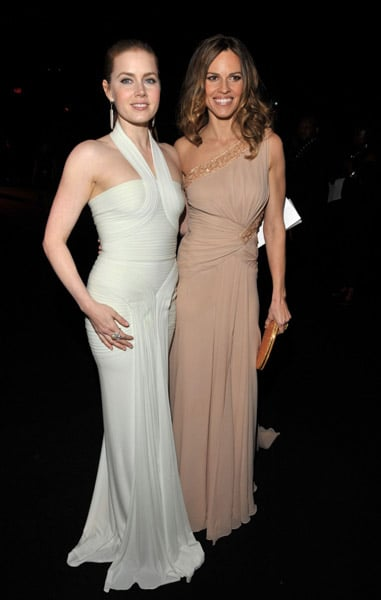 Amy Adams and Hilary Swank ought to have stood together all night in their white and nude gowns. Double the gorgeousness!