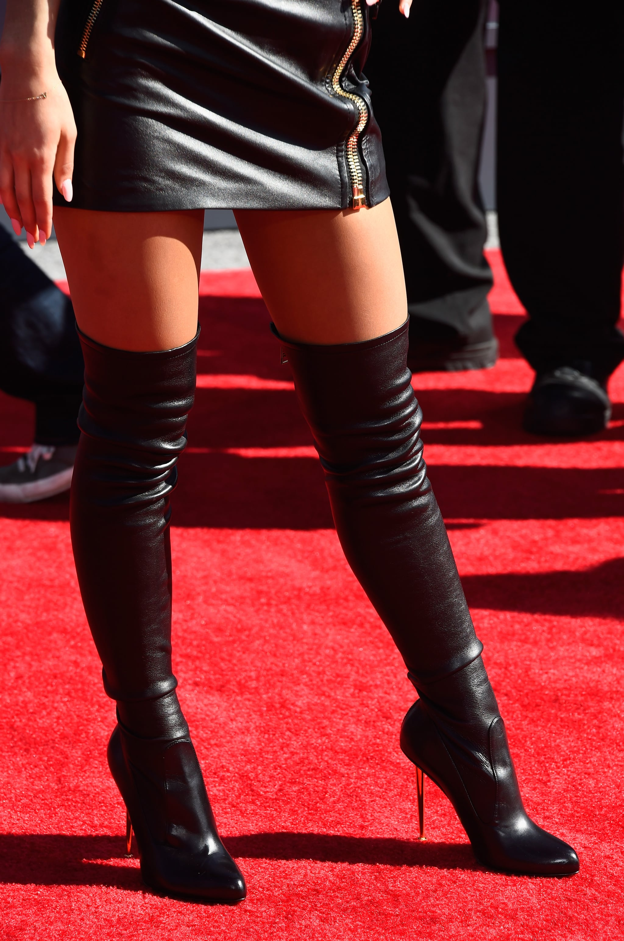 We certainly weren't expecting such a sexy look from Ariana Grande, who sported these thigh-high Tom Ford boots with her Moschino minidress.