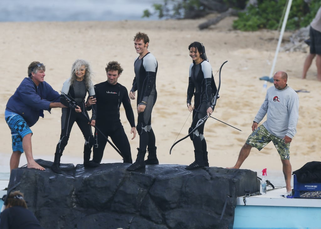 Jennifer Lawrence and her co-stars were taught how to use some serious weaponry as they filmed The Hunger Games: Catching Fire in Hawaii on November 27.