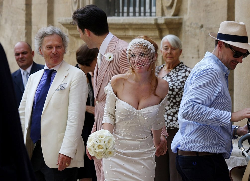 He was decked out in a red and white seersucker suit for the ceremony, while Josephine's dress was made by pal Zac Posen.