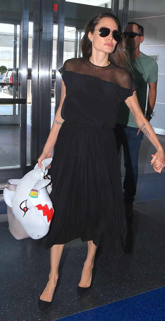Angelina Wore a Midlength Black Dress to the Airport When Leaving NYC