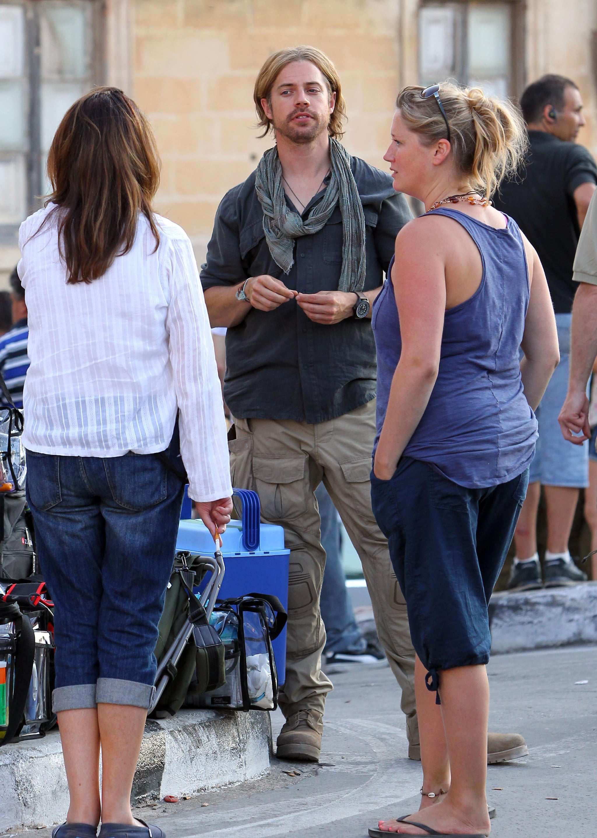 Brad Pitt's stunt double chatted with the crew between scenes.