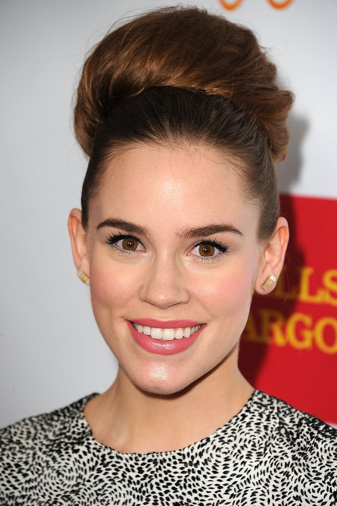 When it comes to topknots, you have miniature versions, and then there are oversize looks like Christa B. Allen's. To achieve the voluptuous size, add some extensions near the base of your high ponytail, comb, and pin hair over the top.