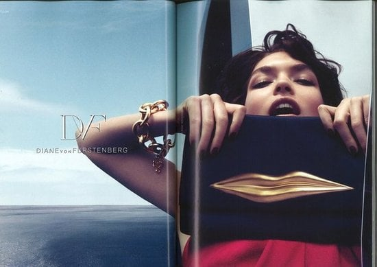 Arizona Muse poses with Diane von Furstenberg's lip-embossed clutch.